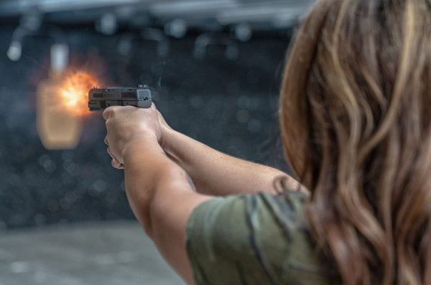 women shooting pistol