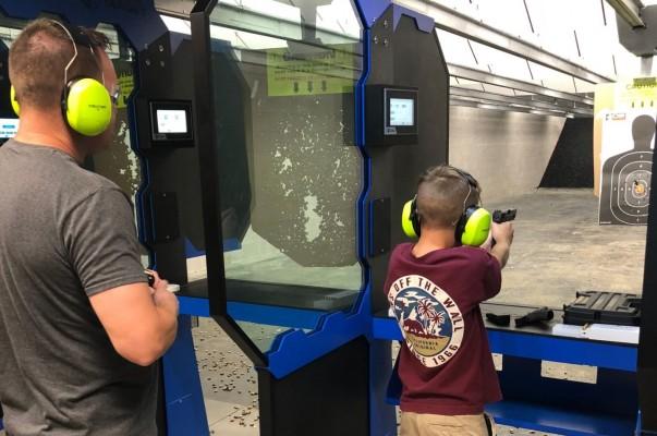 family practicing at the gun range | C2 Tactical
